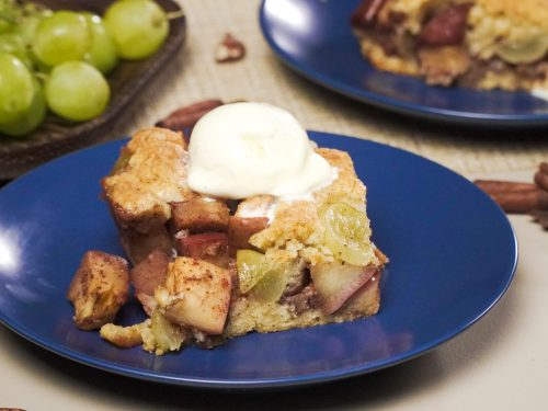 Apple Grape Crumble Recipe, crumble dessert with apples, grapes, and vanilla ice cream topping