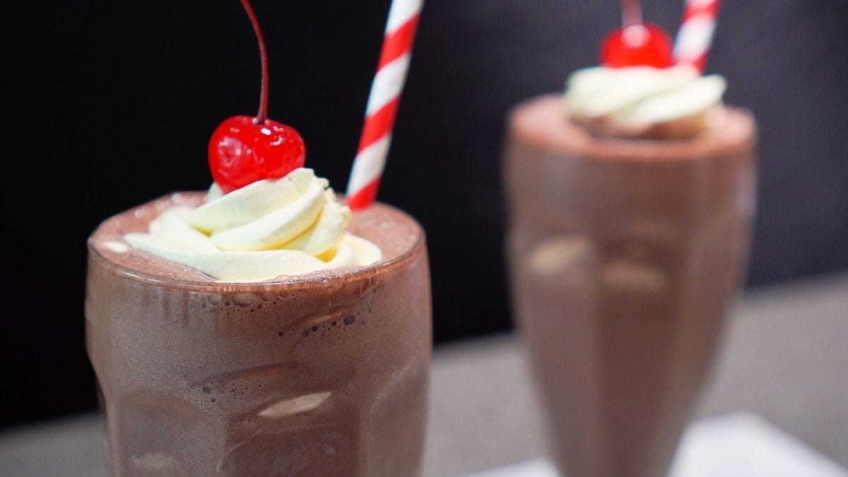 Copycat Chick-fil-A Chocolate Milkshake Recipe - Chick fil a thick and creamy chocolate milkshake topped with whipped cream and cherry
