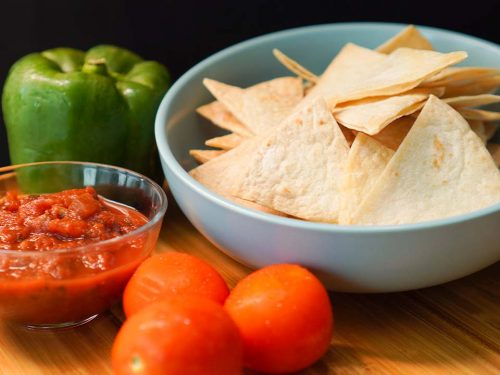 Copycat Chili's Tortilla Chips Recipe - crunchy baked flour tortilla chips with salsa dip