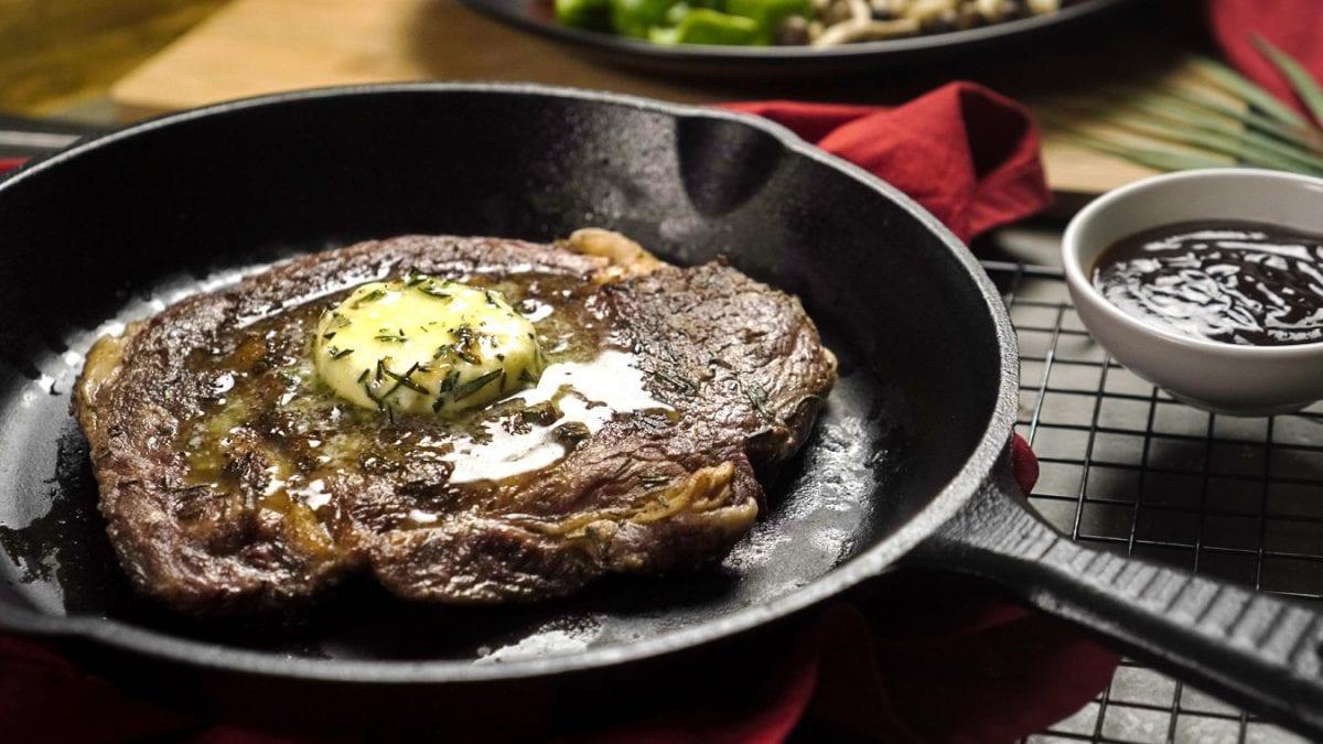 Rosemary Ribeye Steak Recipe- Tender rosemary ribeye steak with a knob of rosemary butter and roasted vegetables.