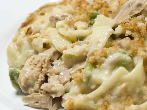 closeup of noodles, tuna and peas in a creamy sauce