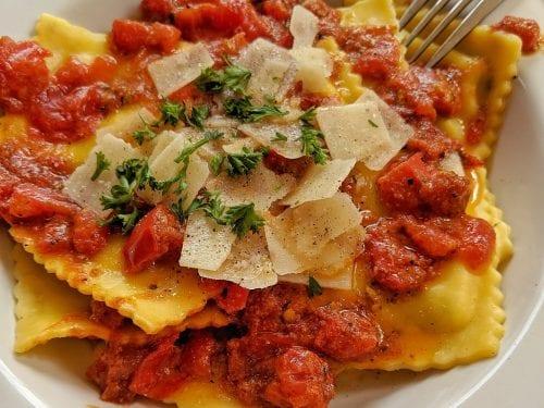 Chicken, Herb and Cheese Ravioli Recipe, ravioli with tomato sauce, cheese, and herbs