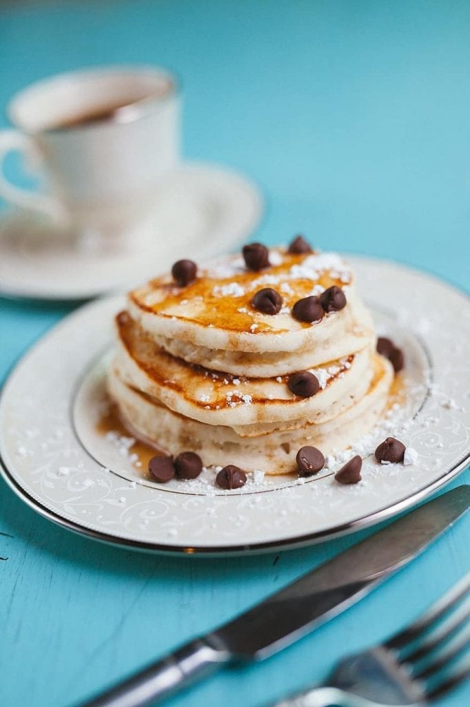 Triple chocolate pancakes. Chocolate pancakes with mini chocolate chips and a chocolate drizzle. #chocolate #pancake @sweetasacookie