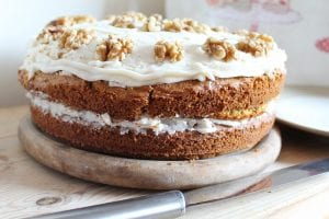 carrot cake with icing and walnuts