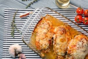 baked parmesan chicken in a glass baking dish