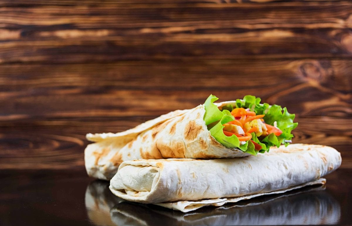 two grilled chicken and vegetable wraps