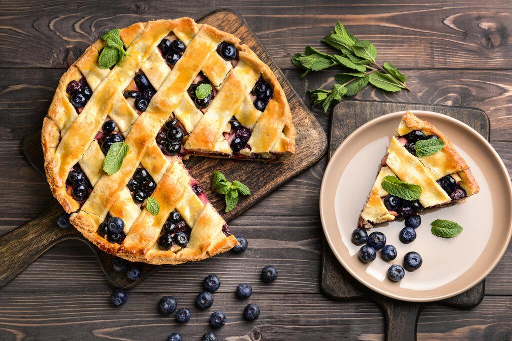 Humble Huckleberry Pie Recipe, huckleberry pie with woven lattice top and huckleberries