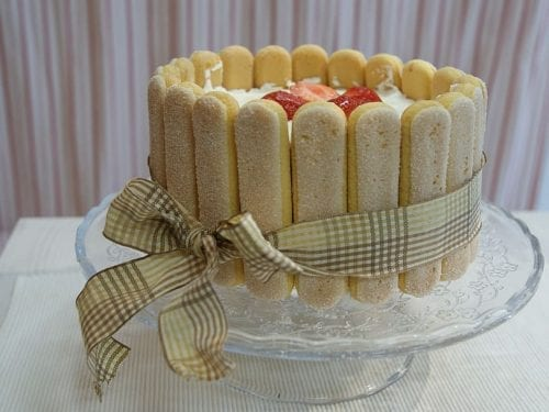 no-bake cake made with ladyfingers and tied with a ribbon in front