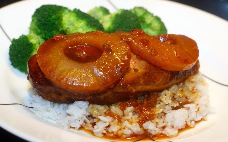 Hawaiian chicken with pineapple chunks over rice