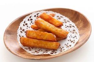 glazed sweet potato strips on a wooden bowl