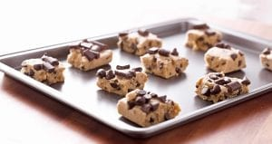 Cookie Dough Stuffed Cookies | Eggless raw cookie dough stuffed inside soft and chewy chocolate cookies via sweetasacookie.com #cookiedough #chocolate