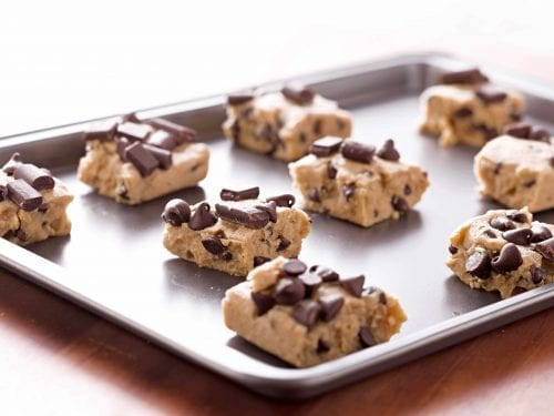chunks of cookie dough on a baking sheet