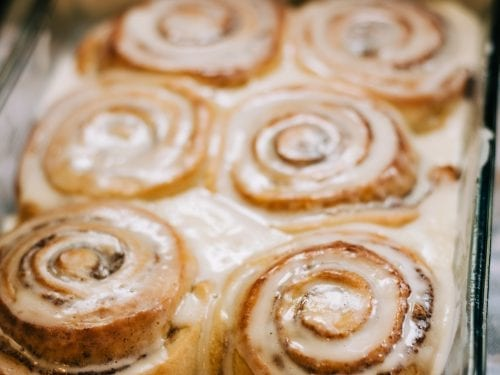 cinnamon rolls in a glass baking dish