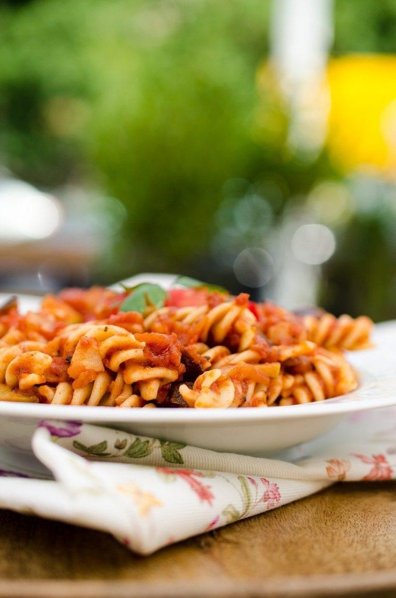 rotini pasta in a tomato-based sauce