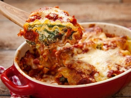 spinach lasagna made with tomato sauce and cheese