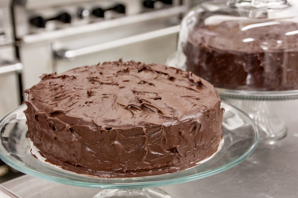 layered chocolate-frosted cake on display