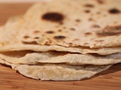 tortillas on a wooden surface