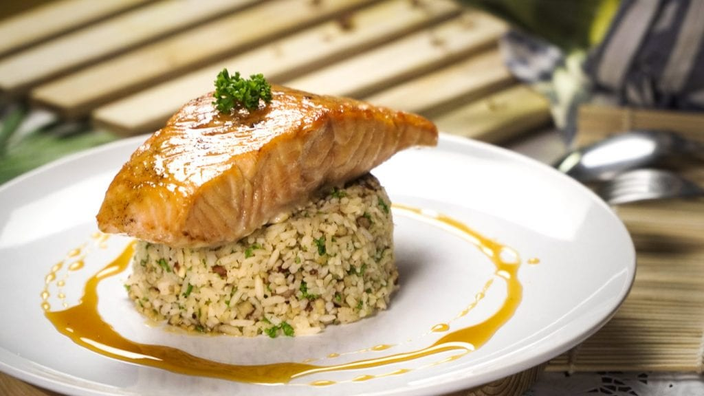 Citrus Glazed Salmon with Pecan-Citrus Rice Recipe - Baked salmon fillet with sweet lemon and honey glaze and orange flavored rice with toasted pecans