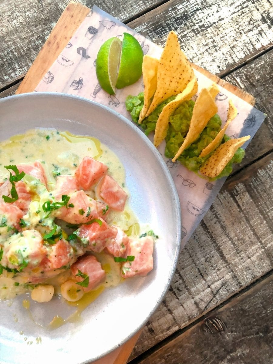 salmon ceviche paired with guac and chips
