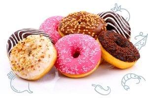 Glazed Pumpkin Donuts | Yeast-less fried pumpkin spice pumpkin doughnuts via sweetasacookie.com #doughnuts #pumpkin