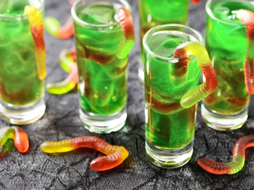 Wormy Swamp Punch Recipe, Halloween green swamp juice cocktail with gummy worms