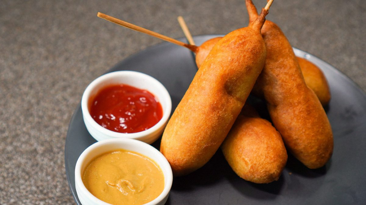 Copycat Hot Dog On A Stick Corn Dogs Recipe - Skewed savory hot dogs covered in toasty cornbread.