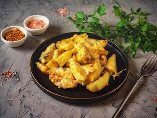 Cheesy Baked Potato Wedges Recipe, oven baked crispy loaded potato wedges