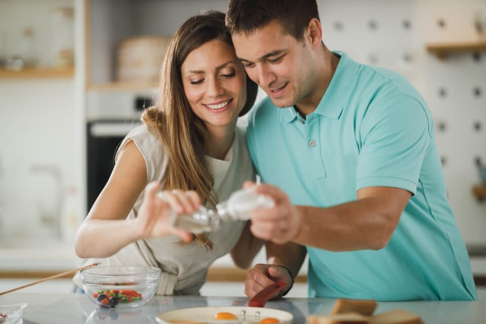 savory herb cooking food seasoning happy couple cooking in kitchen
