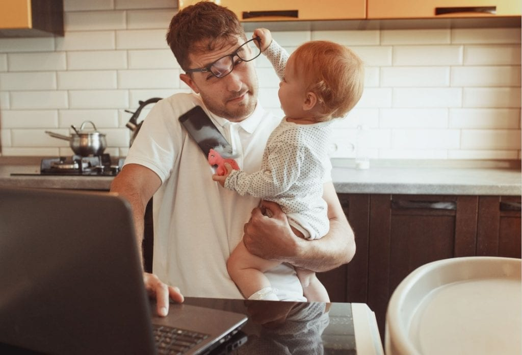 what do new moms dads really need, busy parent with baby