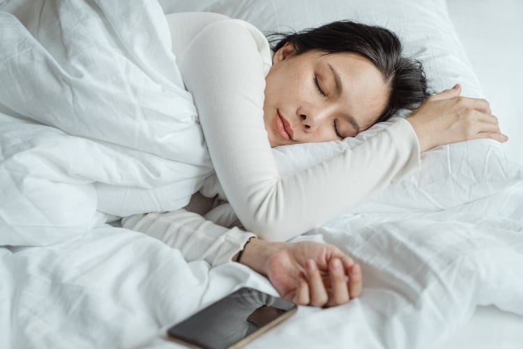 black currant tea benefits, sleeping woman, good sleep benefit