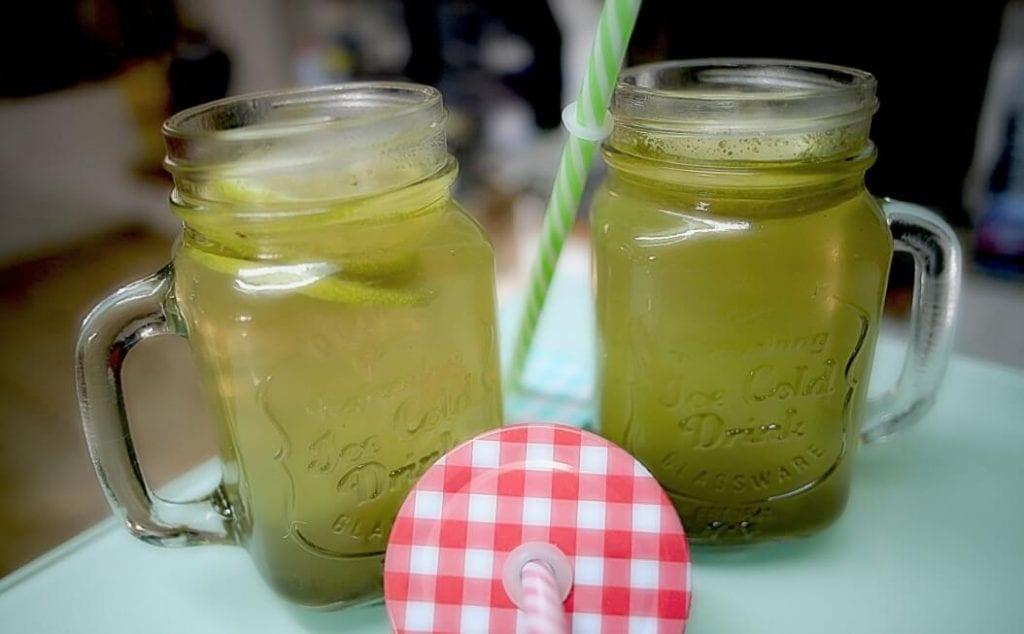 mugs of green sun tea