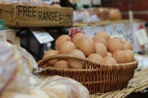 bunch of eggs inside a wooden basket