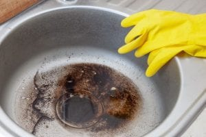 how to unclog kitchen sink filled with cooking oil