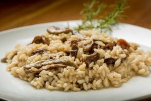 side view shot of a serving of mushroom risotto, risotto recipe, rice risotto vegetables