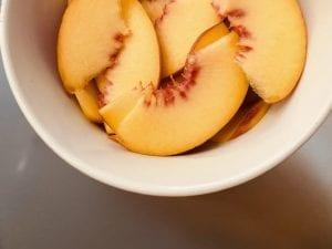 peach slices inside a bowl