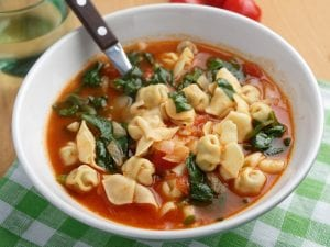 a bowl of tortellini vegetable soup