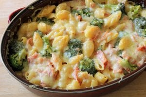 Conchiglie or shell pasta with white sauce and bits of vegetables