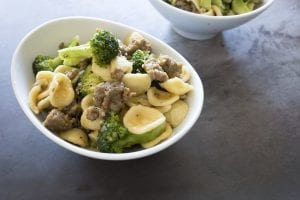 Bowl of orecchiette with meat and broccoli