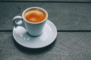 espresso shot inside a cup with saucer