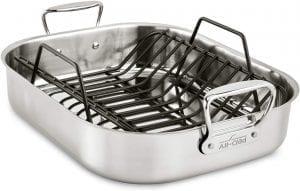 Metal roasting pan with black cooking rack