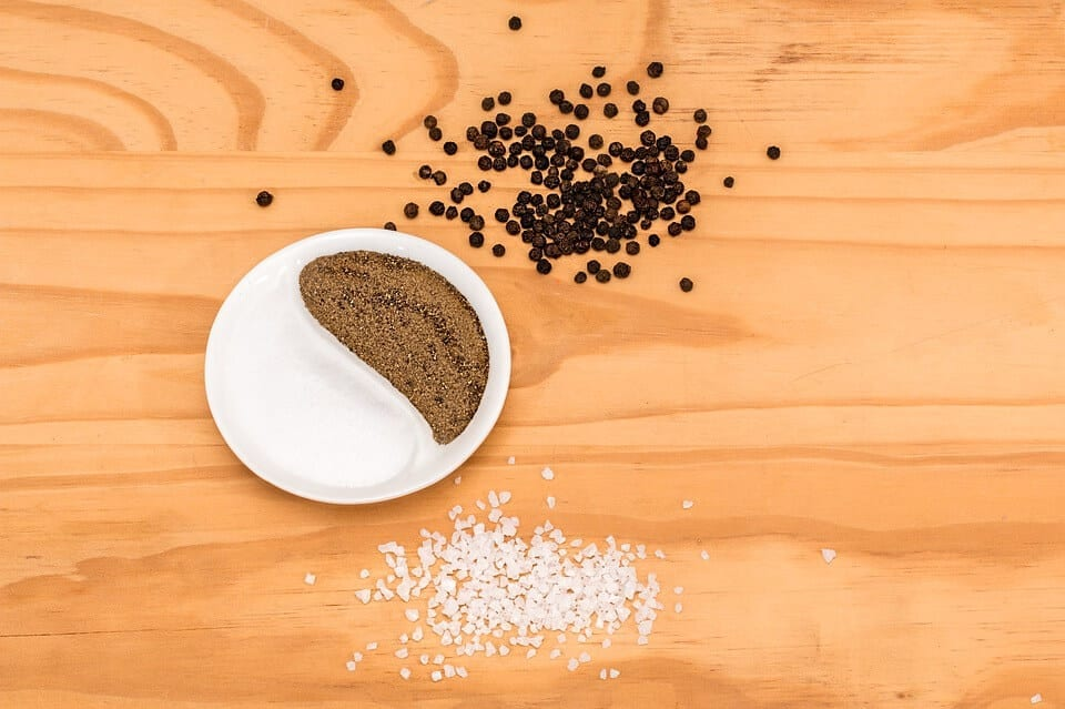 ground celery seed and salt, spices on a white plate