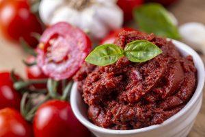 a small bowl of tomato paste