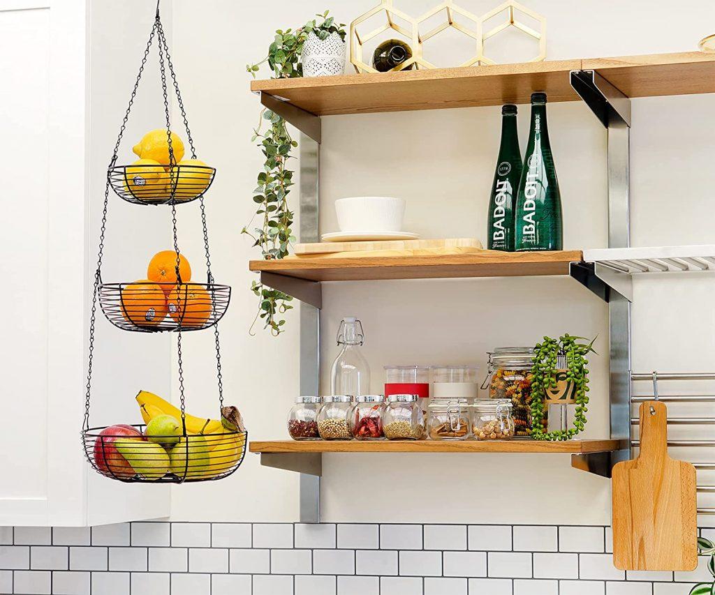 Durable steel hanging fruit basket near kitchen shelves