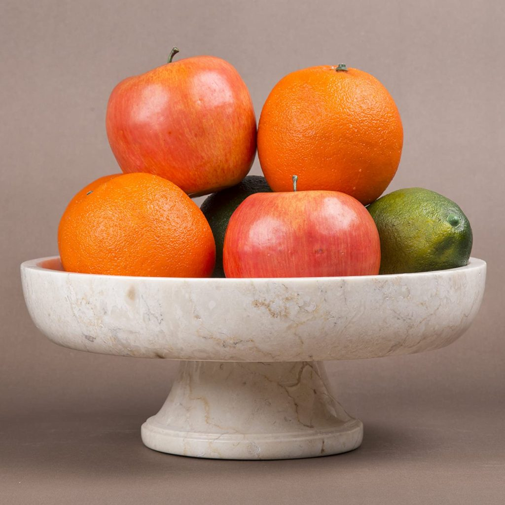 Marble pedestal stand with fruits