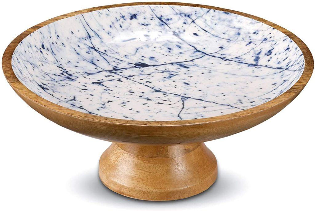 Wooden pedestal fruit bowl with a blue marble design