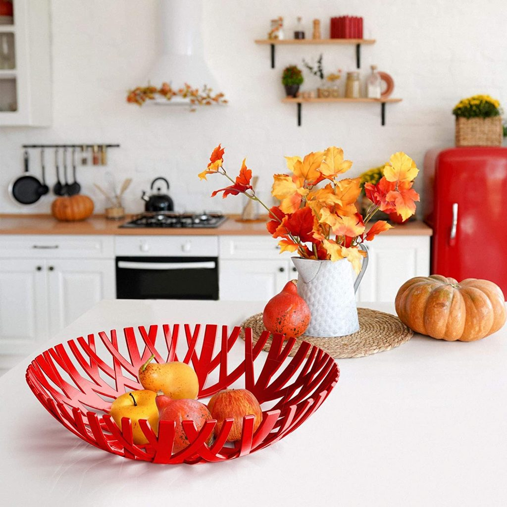Red plastic fruit basket on countertop