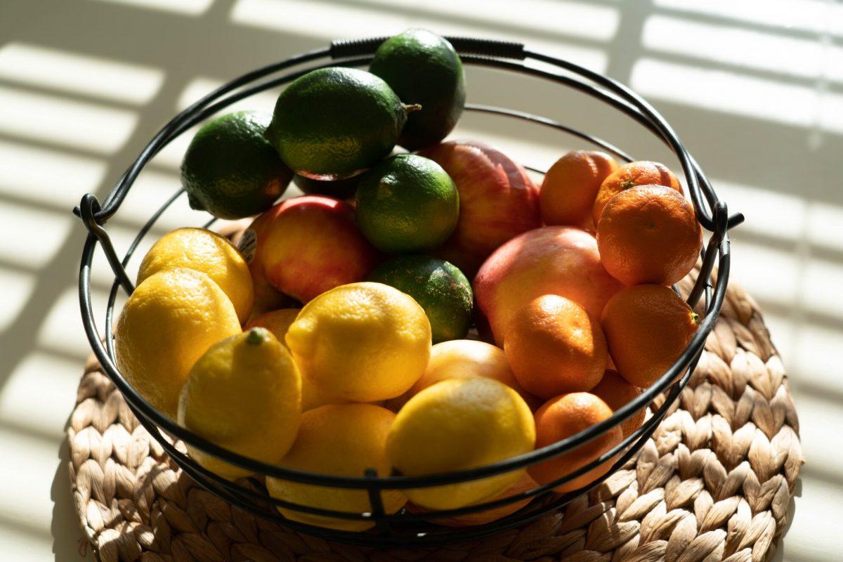 Fruits in metal wire fruit baskets