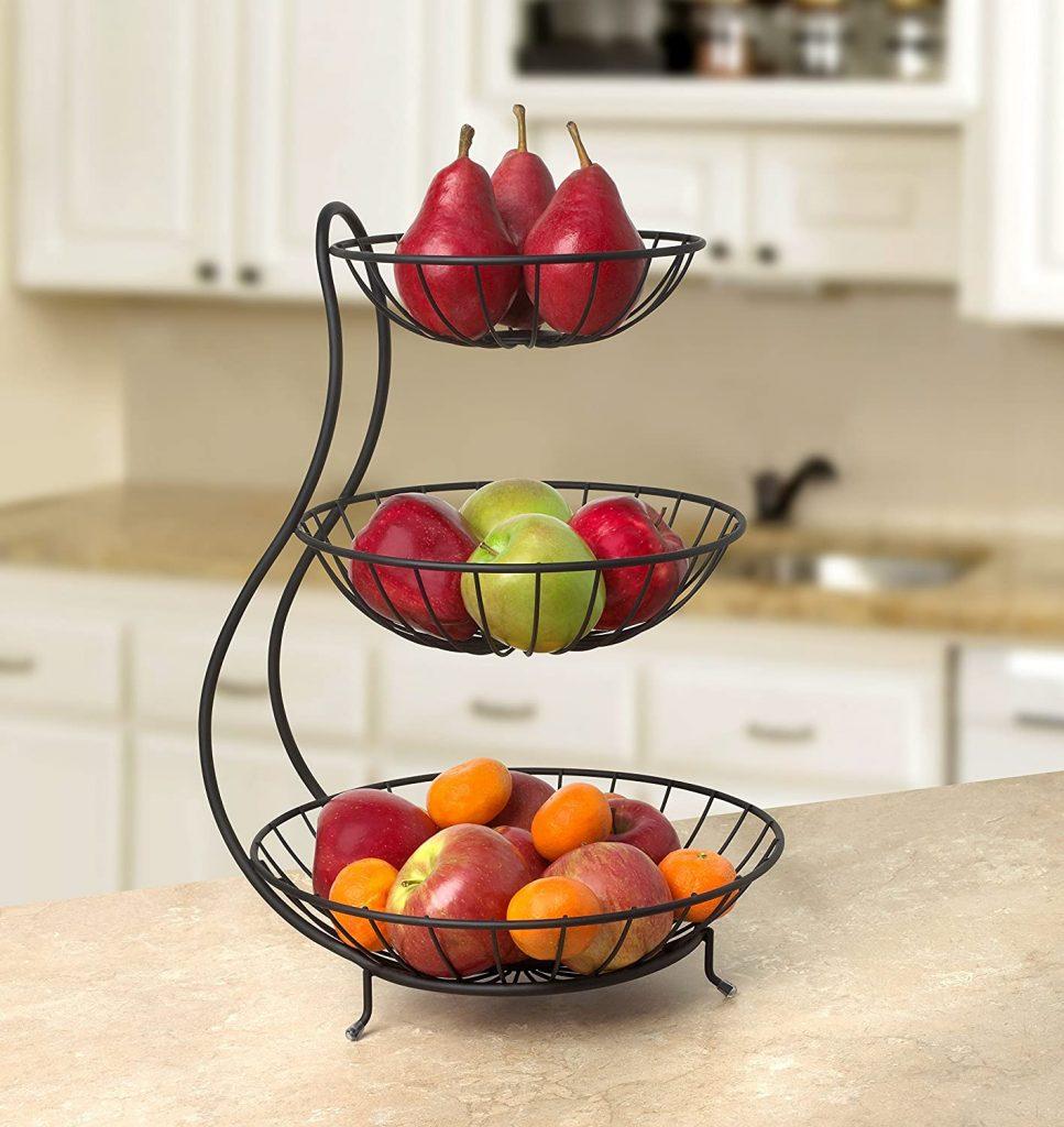 Sleek black three tiered fruit stand on countertop