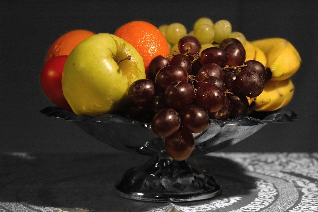 Pedestal silver fruit bowl on table
