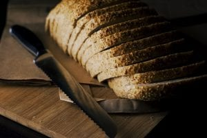 a serrated knife and sliced loaves of bread